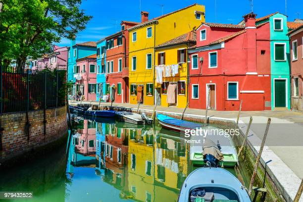 boats in canal and colorful houses, burano, venice, italy - burano foto e immagini stock