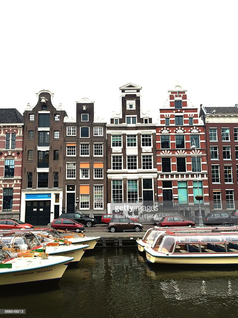 Boats In Canal In Front Of Buildings Against Clear Sky : Stock Photo