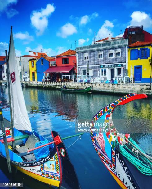 boats in canal - aveiro district stock pictures, royalty-free photos & images