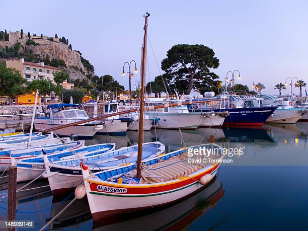 Boats in Cassis harbour at dusk.