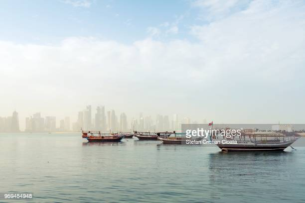 boats in dhow harbour doha, qatar - passenger craft stock pictures, royalty-free photos & images