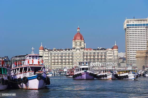 Boats in front of Taj Mahal Tower and Plaza Hotel, Mumbai, India