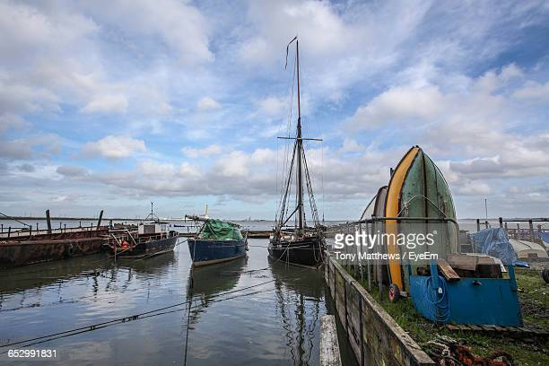 boats in harbor against sky - gillingham stock pictures, royalty-free photos & images