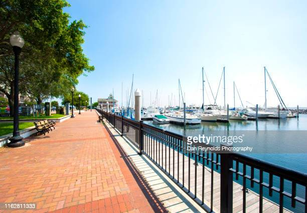 boats in harbor - boardwalk stock pictures, royalty-free photos & images