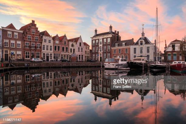 boats in harbour and buildings by waterfront; goes, zeeland, netherlands - zeeland stock pictures, royalty-free photos & images