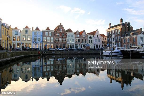 Boats in harbour and buildings by waterfront; Goes, Zeeland, Netherlands