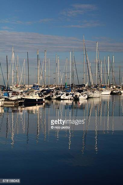 boats in koper harbour - koper stock photos and pictures