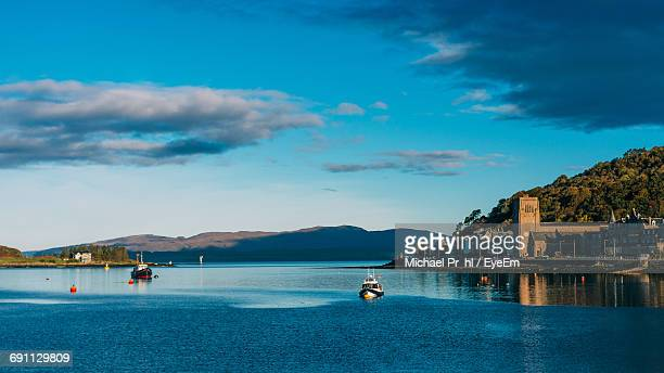 Boats In Lake Against Blue Sky