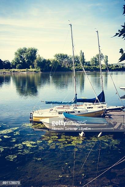 boats in lake - albrecht schlotter stock photos and pictures