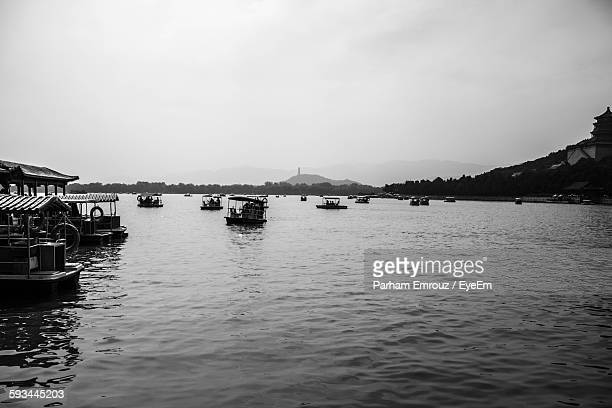 boats in river against sky - parham emrouz stock pictures, royalty-free photos & images