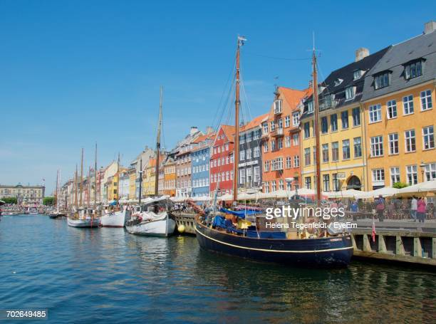 boats in river with buildings in background - nyhavn stock pictures, royalty-free photos & images