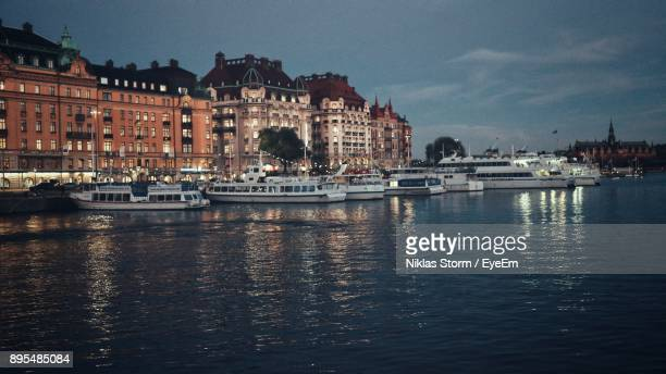 boats in river with buildings in background - niklas storm eyeem stock photos and pictures
