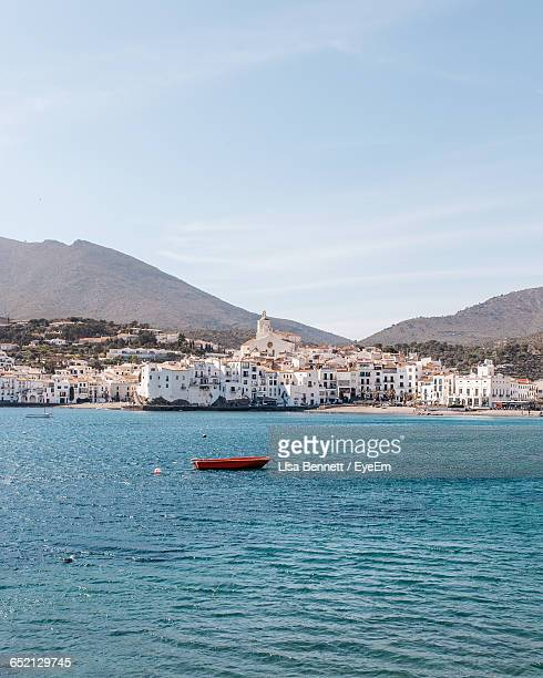 boats in river with cityscape in background - cadaques stock pictures, royalty-free photos & images