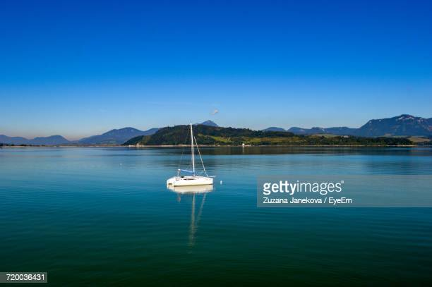 boats in sea against blue sky - zuzana janekova stock pictures, royalty-free photos & images
