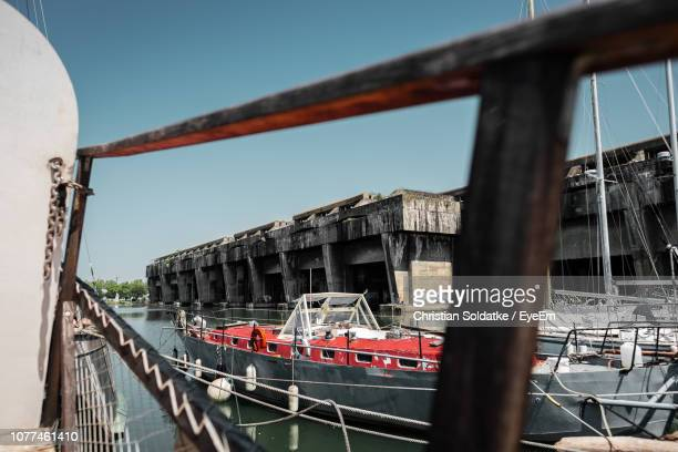 boats in sea against built structure - christian soldatke stock pictures, royalty-free photos & images