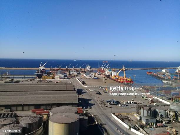 boats in sea against clear blue sky - oran algeria photos et images de collection