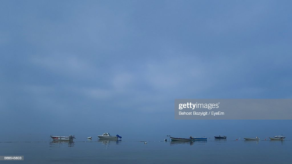 Boats In Sea Against Cloudy Sky : Stock Photo