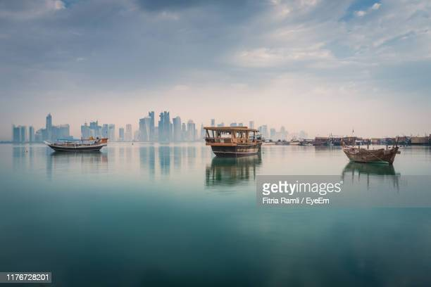 boats in sea against sky - doha stockfoto's en -beelden