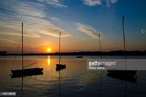 boats in sea at sunset - rolour garcia stock pictures, royalty-free photos & images
