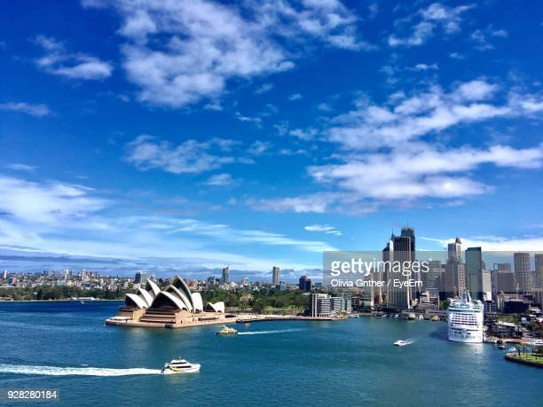 boats in sea with city in background - opera house stock pictures, royalty-free photos & images