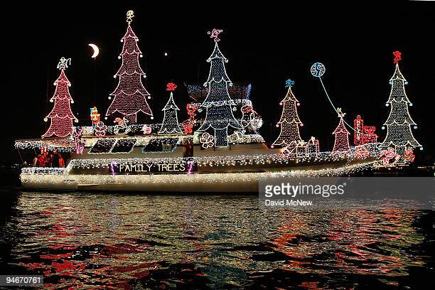 Boats in the 101st annual Newport Beach Christmas Boat Parade are lit with Christmas decorations as they move through through the night on December...