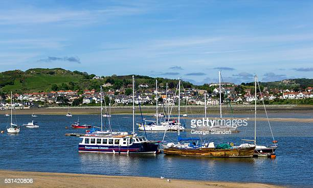 boats in the estuary at conway, north wales - george conway stock photos and pictures