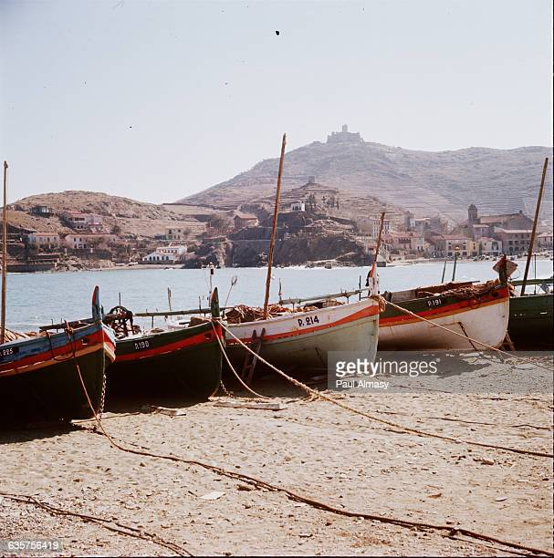 Boats in the fishing village of Collioure near the Spanish border on the southeast coast of France On top of the hill behind is a 12th century castle