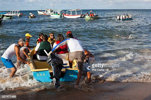 Boats in the sea fishermen taking people out to make offerings to Yemanja February 2nd is the feast of Yemanja a Candomble Umbanda religious...