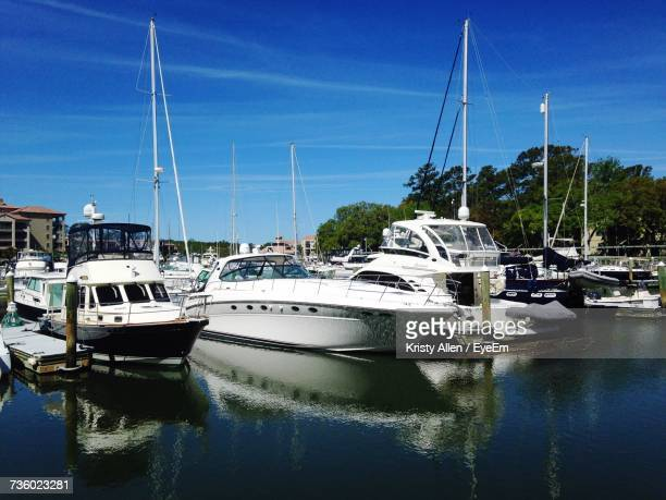boats in water against clear sky - hilton head stock pictures, royalty-free photos & images