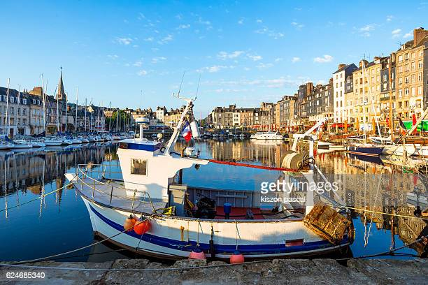 Boats in water at Old Basin of Honfleur with blue sky in day, France
