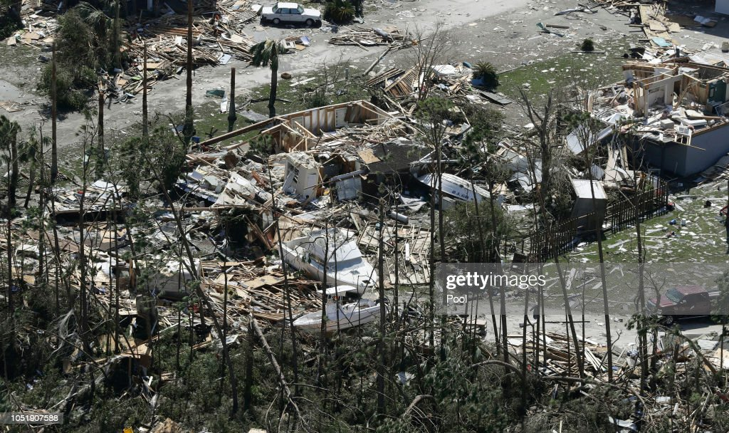 Boats lay among the debris from homes destroyed by Hurricane