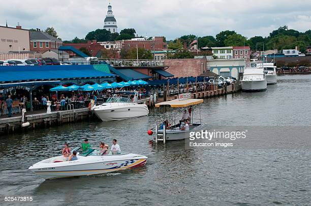 Boats leave the harbor in Annapolis Maryland