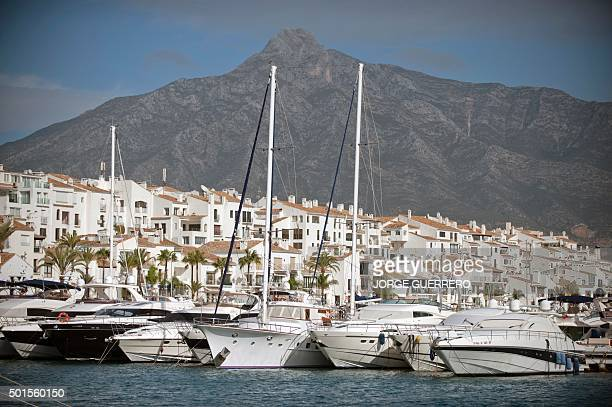 Boats lie at dock in Puerto Banus near Marbella on November 21 2015 The number of millionaires in Spain defined as having a fortune of over a million...
