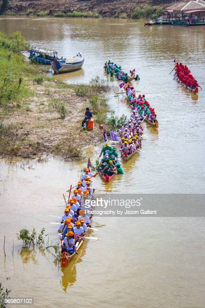 boats lining up in the sangkae river for the water festival boat races. - khmer stock pictures, royalty-free photos & images