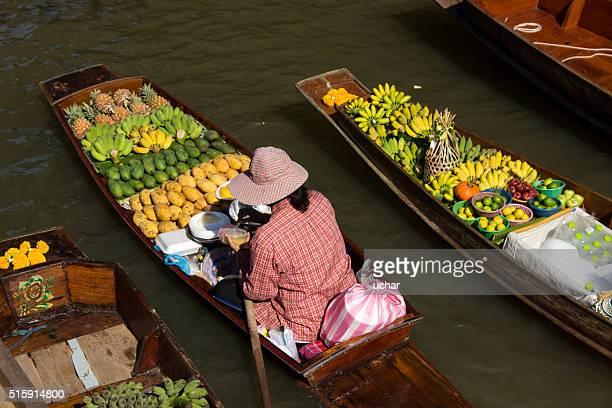 Boats loaded with fruits in Damnoen Saduak Floating Market, Thailand