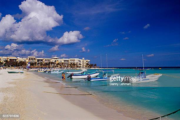 boats moored along playa del carmen shoreline - playa del carmen stock pictures, royalty-free photos & images
