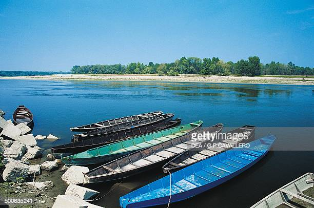 Boats moored along the Po River near Valenza Piedmont Italy