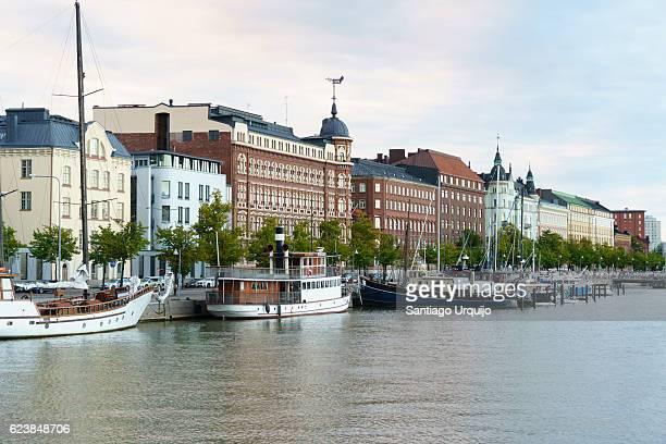 Boats moored alongside promenade in old town of Helsinki