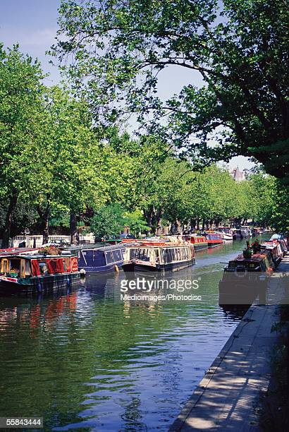 boats moored at a canal, little venice, london, england - paddington london stock pictures, royalty-free photos & images