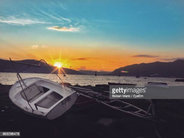 boats moored at beach during sunset - boban stock pictures, royalty-free photos & images