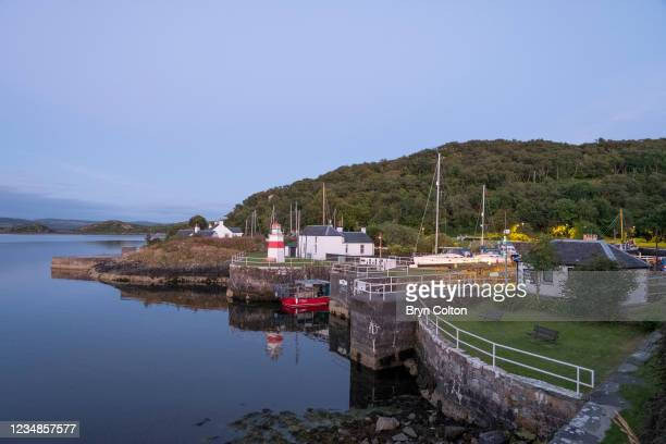 Boats moored at dusk in the sea locks at the entrance to the Crinan Canal on August 19, 2021 in Crinan, Scotland. Passage along the canal has been...