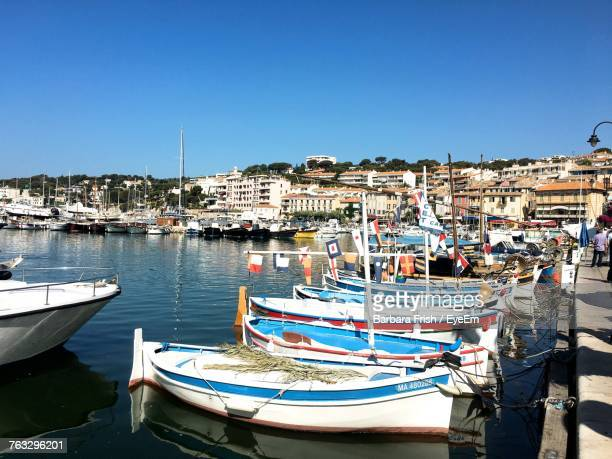 boats moored at harbor against clear blue sky - cassis stock pictures, royalty-free photos & images