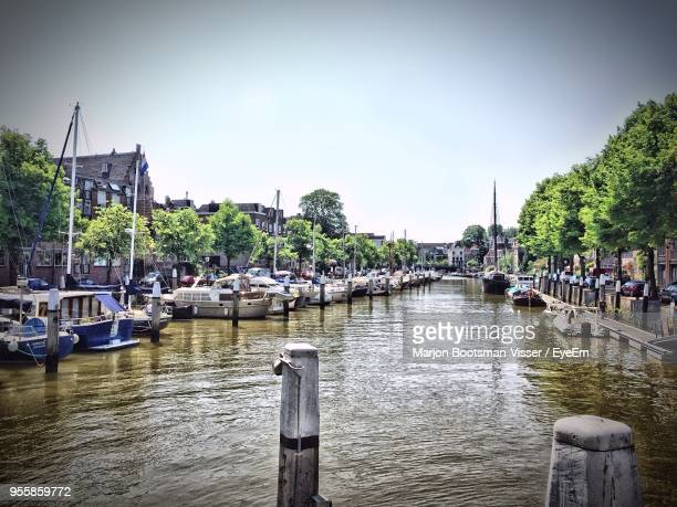 boats moored at harbor against clear sky - dordrecht stock pictures, royalty-free photos & images