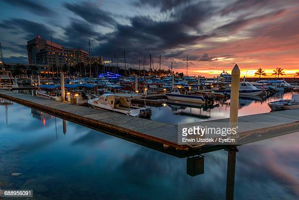 Boats Moored At Harbor Against Sky During Sunset In City