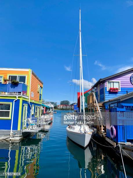 boats moored at harbor against sky - futa stock photos and pictures