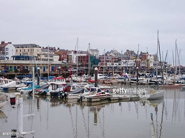 boats moored at harbor against sky - bridlington stock pictures, royalty-free photos & images