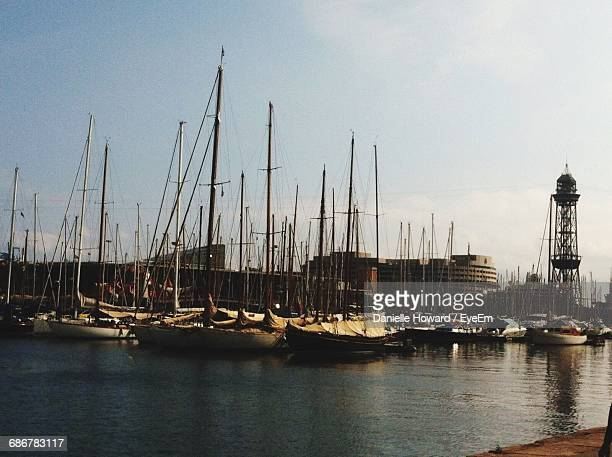 boats moored at harbor against sky - howard,_wisconsin stock pictures, royalty-free photos & images