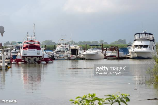 boats moored at harbor against sky - eileen kirsch stock pictures, royalty-free photos & images