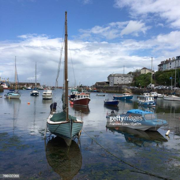 boats moored at harbor against sky - exeter england stock pictures, royalty-free photos & images