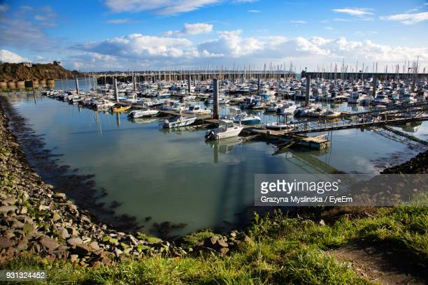 Boats Moored At Harbor Against Sky